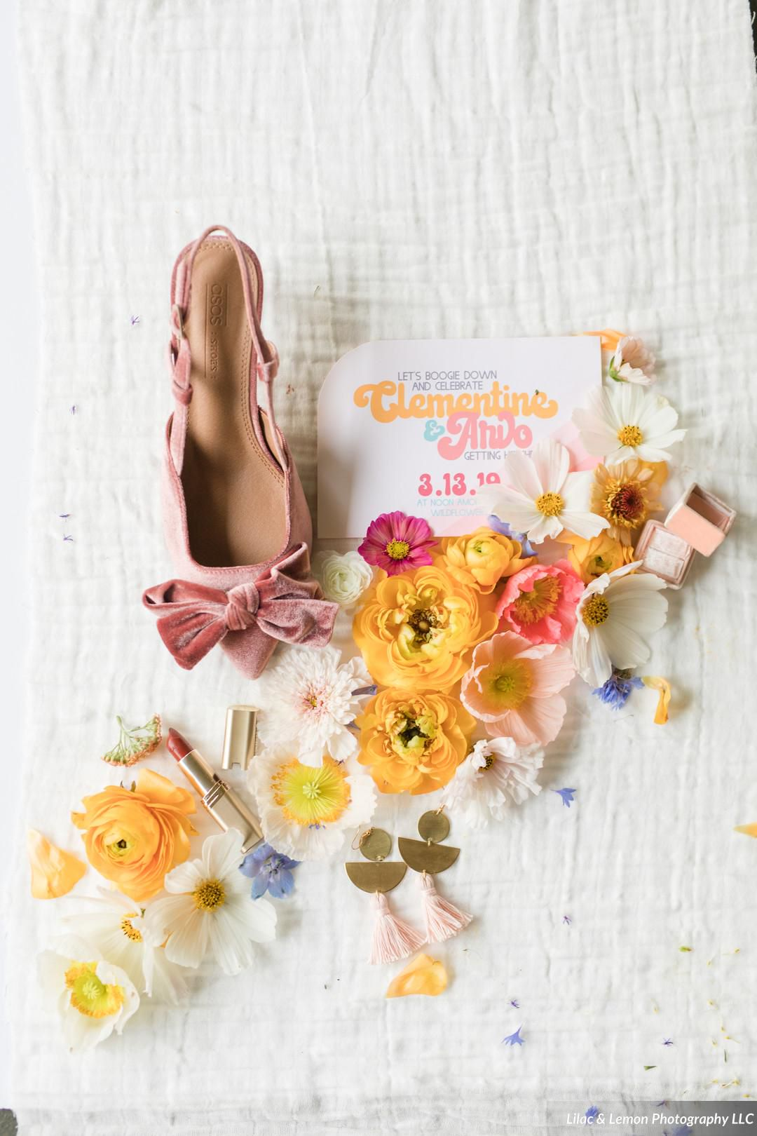 Custom 70's Inspired Wedding Invitation Suite | Colorful Geometric Envelope liner, Papaya Orange Envelopes and a double thick RSVP card surrounded by Wildflowers | Flowers by Field + Forage, Stationery by Beauty Bright Design